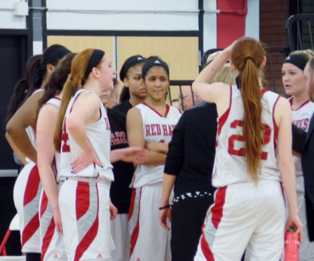Montclair State players huddle during timeout