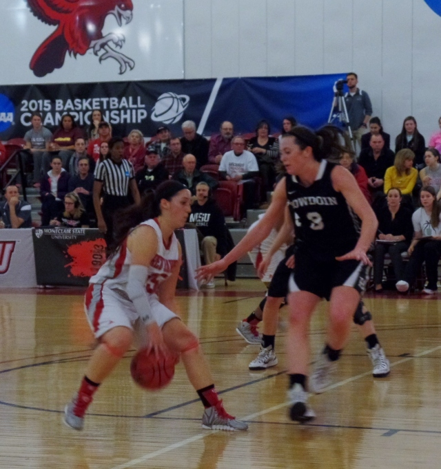 Montclair player dribbling during game against Bowdoin