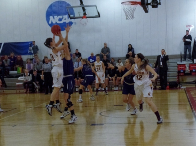 Salisbury player takes jump shot about Amherst