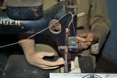 Robot at sewing machine