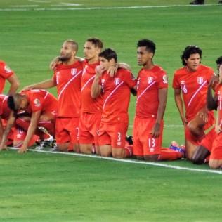 Peru looks on