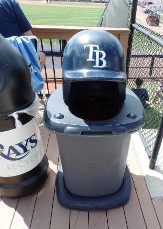 Rays helmet atop trash can
