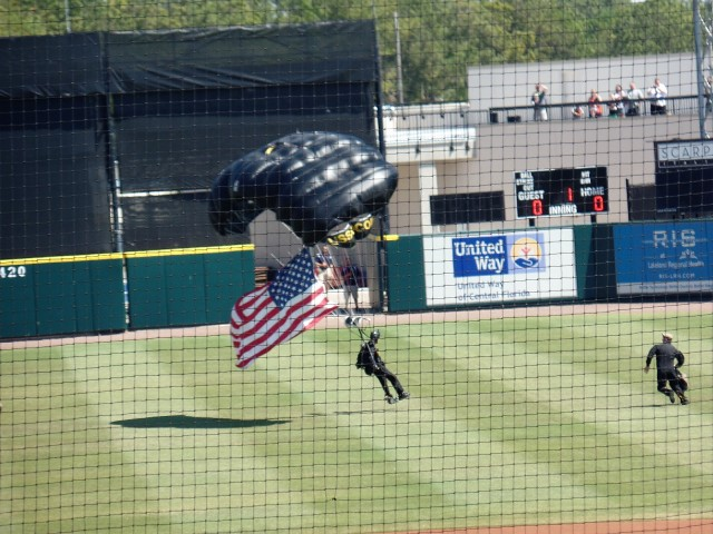 skydivers at Joker Marchand Stadium