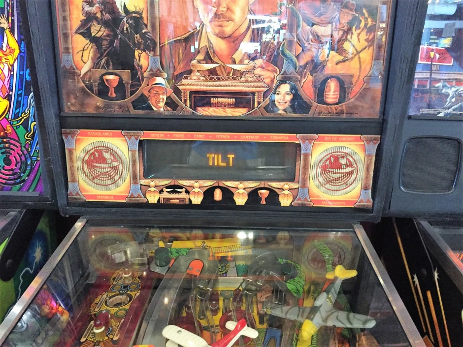 Tilted pinball machine
