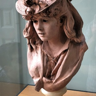 Young Girl with Flowers on Her Hat