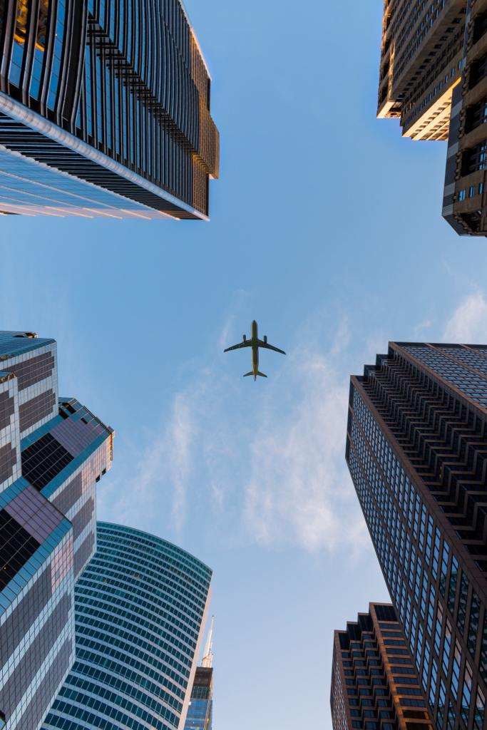 plane and skyscrapers