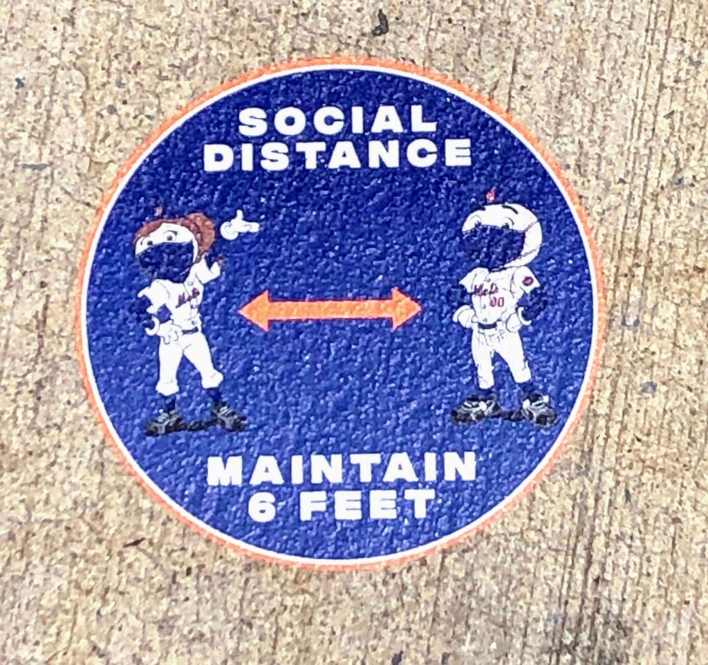 Mr. and Mrs. Met social distancing
