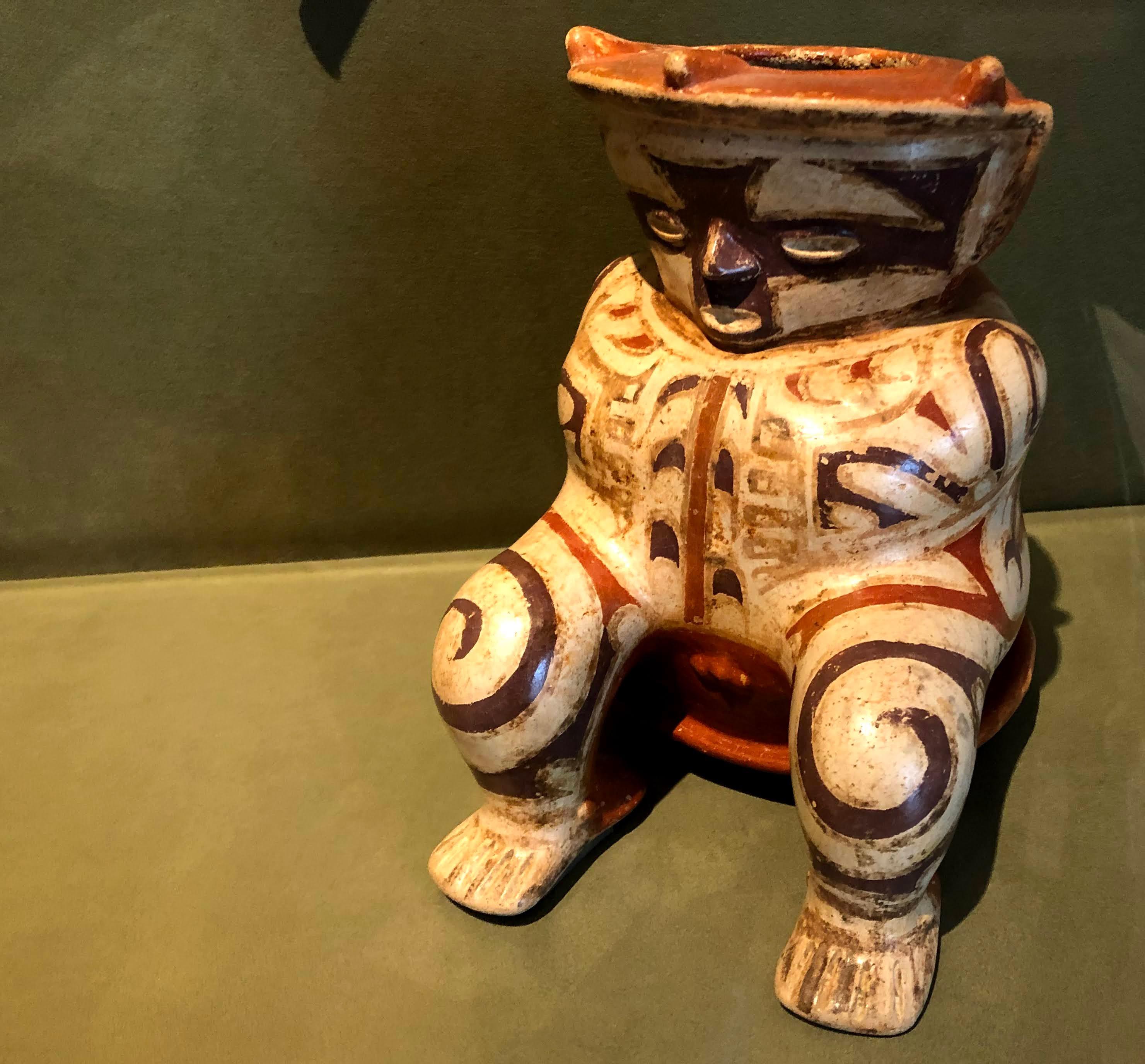 Hunchbacked figure vessel